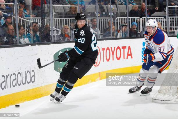 Marcus Sorensen of the San Jose Sharks skates after the puck against Connor McDavid of the Edmonton Oilers at SAP Center on April 6 2017 in San Jose...