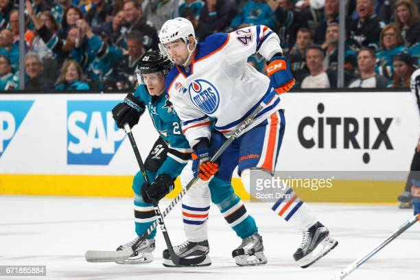Marcus Sorensen of the San Jose Sharks skates against Anton Lander of the Edmonton Oilers in Game Four of the Western Conference First Round during...