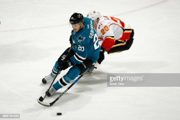 Marcus Sorensen of the San Jose Sharks skates against Curtis Lazar of the Calgary Flames at SAP Center at San Jose on April 8 2017 in San Jose...