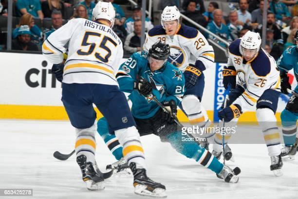 Marcus Sorensen of the San Jose Sharks skates against Rasmus Ristolainen Jake McCabe and Matt Moulson of the Buffalo Sabres at SAP Center at San Jose...