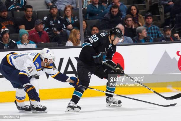 Marcus Sorensen of the San Jose Sharks skates against Robert Bortuzzo of the St Louis Blues at SAP Center on March 16 2017 in San Jose California