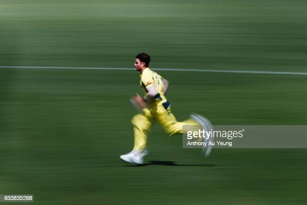 Marcus Stoinis of Australia runs up to bowl during game three of the One Day International series between New Zealand and Australia at Seddon Park on...