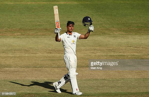 Marcus Stoinis of the Bushrangers celebrates and acknowledges the crowd after scoring a century during day two of the Sheffield Shield match between...