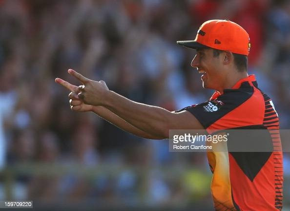 Marcus Stoinis of the Scorchers celebrates taking a catch to dismiss Luke Pomersbach of the Heat during the Big Bash League final match between the...