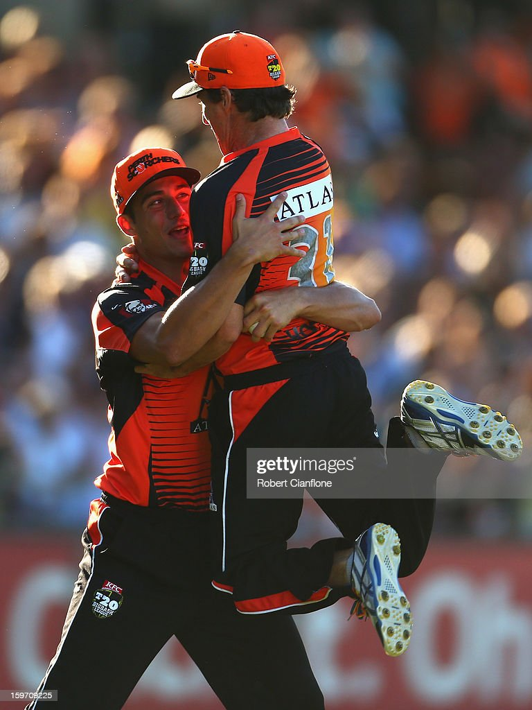 Marcus Stoinis of the Scorchers celebrates with <a gi-track='captionPersonalityLinkClicked' href=/galleries/search?phrase=Brad+Hogg&family=editorial&specificpeople=211604 ng-click='$event.stopPropagation()'>Brad Hogg</a> after taking a catch to dismiss Luke Pomersbach of the Heat during the Big Bash League final match between the Perth Scorchers and the Brisbane Heat at the WACA on January 19, 2013 in Perth, Australia.