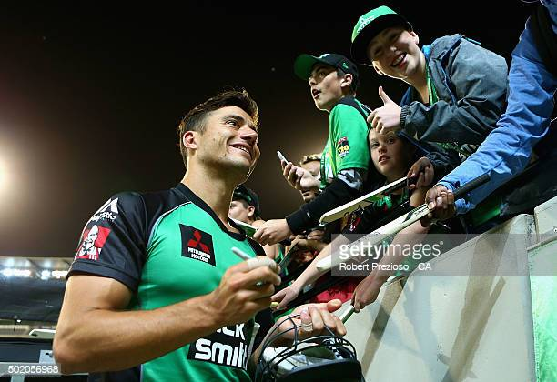 Marcus Stoinis of the stars signs autographs for fans during the Big Bash League match between Melbourne Stars and Sydney Thunder at Melbourne...