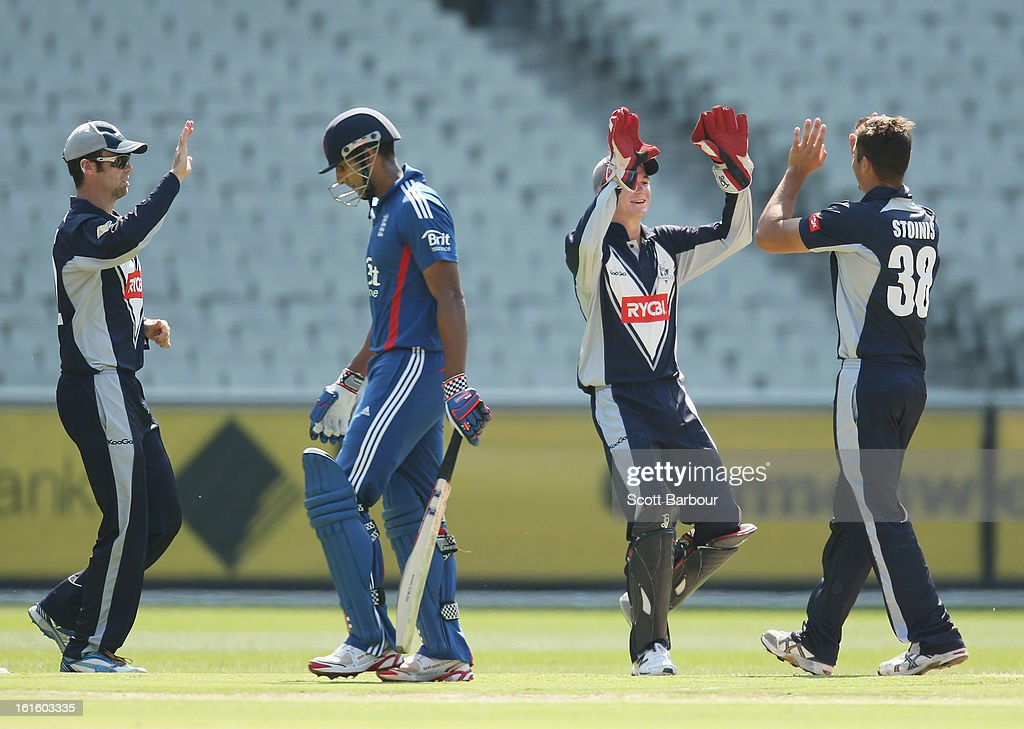 Marcus Stoinis (R) of Victoria celebrates with his team mates after dismissing <a gi-track='captionPersonalityLinkClicked' href=/galleries/search?phrase=Varun+Chopra&family=editorial&specificpeople=734731 ng-click='$event.stopPropagation()'>Varun Chopra</a> of the Lions during the international tour match between Victoria and the England Lions at the Melbourne Cricket Ground on February 13, 2013 in Melbourne, Australia.