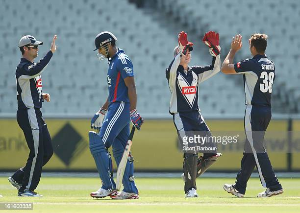Marcus Stoinis of Victoria celebrates with his team mates after dismissing Varun Chopra of the Lions during the international tour match between...