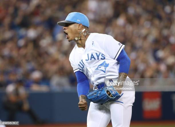 Marcus Stroman of the Toronto Blue Jays celebrates after getting a double play to end the fifth inning during MLB game action against the Chicago...