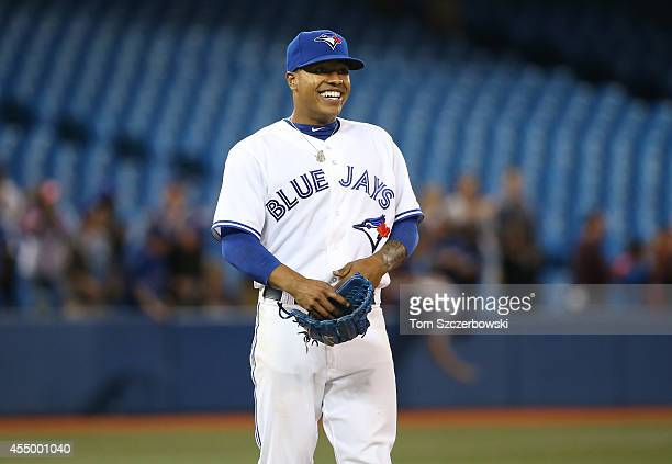 Marcus Stroman of the Toronto Blue Jays celebrates his completegame victory during MLB game action against the Chicago Cubs on September 8 2014 at...
