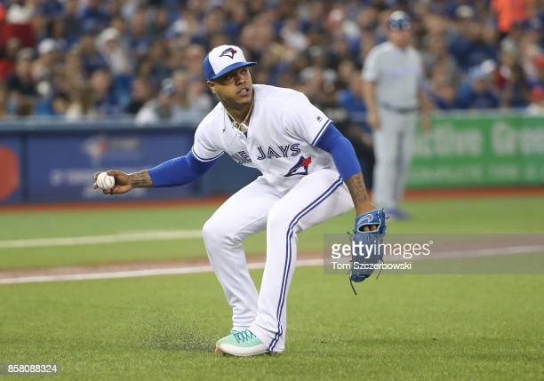 Marcus Stroman of the Toronto Blue Jays fields a soft grounder and throws out the baserunner to end the seventh inning during MLB game action against...