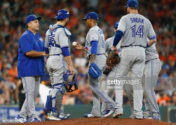Marcus Stroman of the Toronto Blue Jays hands the ball to manager John Gibbons as he leaves in the seventh inning against the Houston Astros at...
