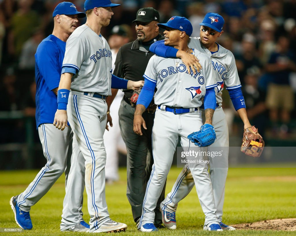 Marcus Stroman #6 of the Toronto Blue Jays is restrained by teammates and officials after a confrontation with the Chicago White Sox dugout at Guaranteed Rate Field on August 1, 2017 in Chicago, Illinois.