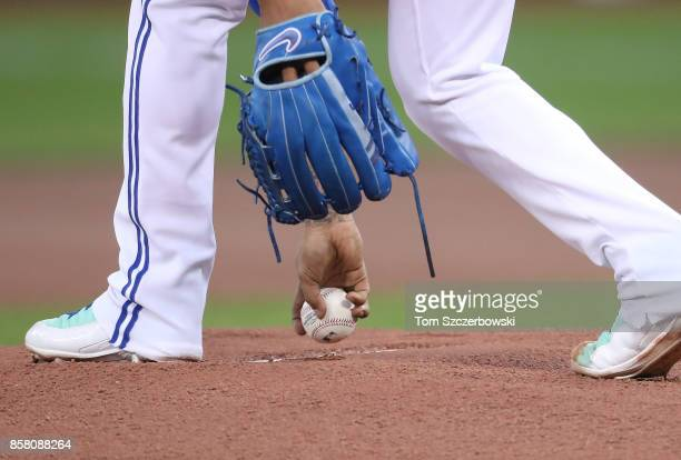 Marcus Stroman of the Toronto Blue Jays picks up the baseball as he takes to the mound as he gets ready to pitch in the first inning during MLB game...