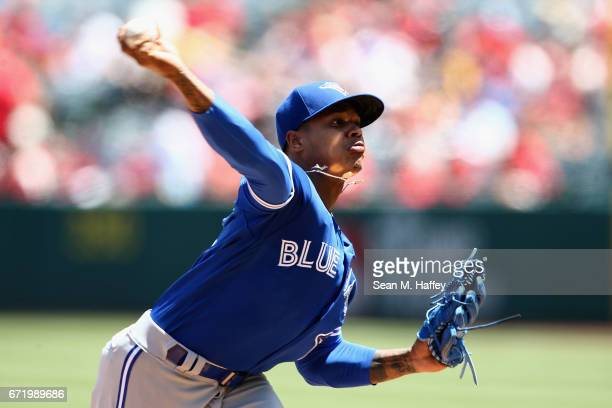 Marcus Stroman of the Toronto Blue Jays pitches during the first inning of a game against the Los Angeles Angels of Anaheim at Angel Stadium of...