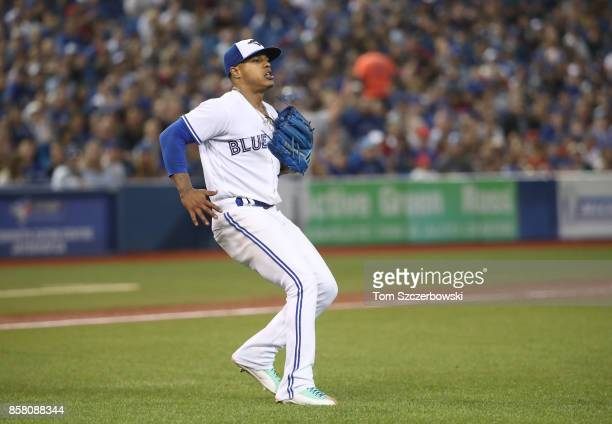 Marcus Stroman of the Toronto Blue Jays reacts after fielding a soft grounder and throwing out the baserunner to end the seventh inning during MLB...