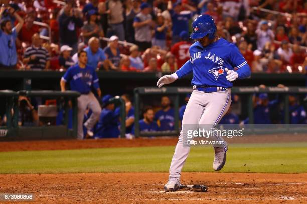 Marcus Stroman of the Toronto Blue Jays scores the gamewinning run against the St Louis Cardinals in the eleventh inning at Busch Stadium on April 25...