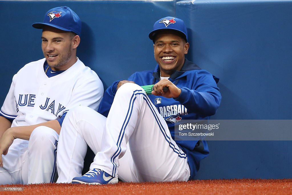 <a gi-track='captionPersonalityLinkClicked' href=/galleries/search?phrase=Marcus+Stroman&family=editorial&specificpeople=7916987 ng-click='$event.stopPropagation()'>Marcus Stroman</a> #6 of the Toronto Blue Jays smiles as he watches the action from the top step of the dugout during MLB game action against the Houston Astros on June 5, 2015 at Rogers Centre in Toronto, Ontario, Canada.