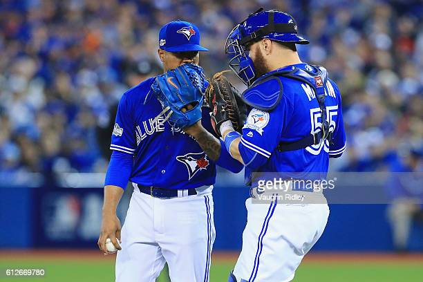 Marcus Stroman of the Toronto Blue Jays talks with Russell Martin on the pitcher's mound in the fourth inning against the Baltimore Orioles during...