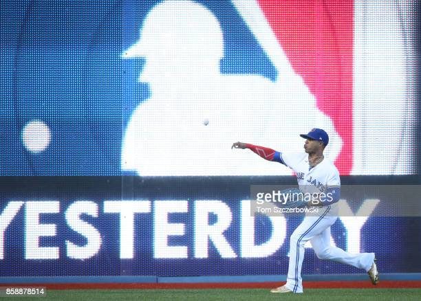 Marcus Stroman of the Toronto Blue Jays warms up doing long toss in the outfield before the start of MLB game action against the Detroit Tigers at...