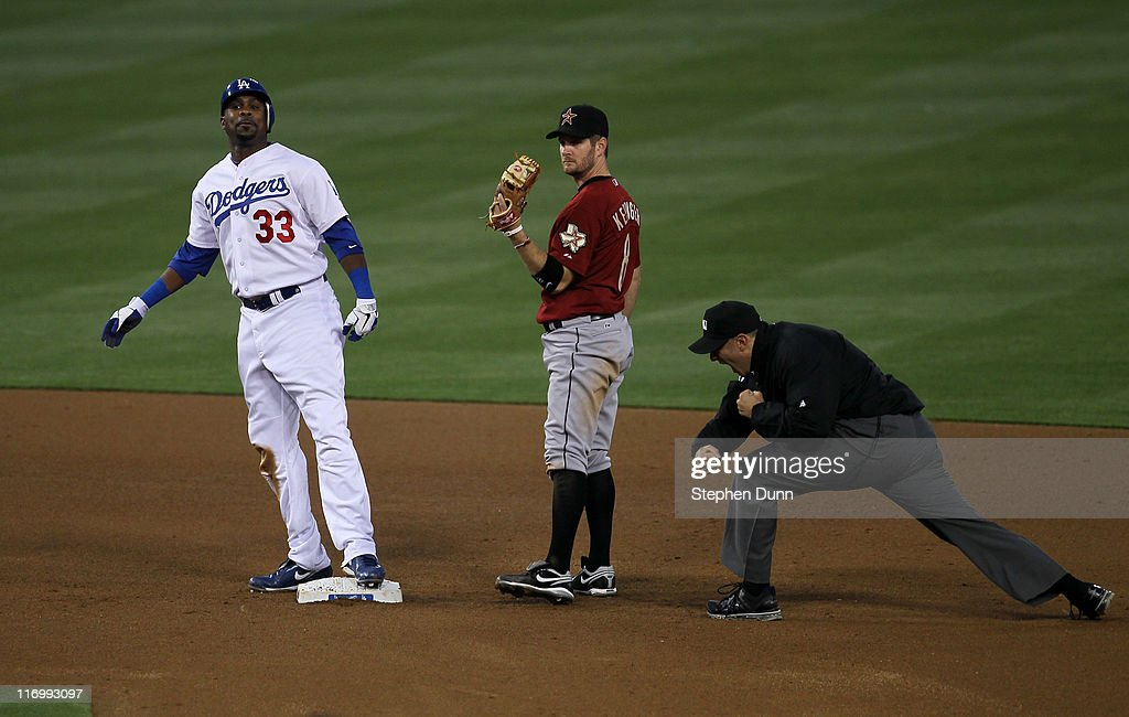 <a gi-track='captionPersonalityLinkClicked' href=/galleries/search?phrase=Marcus+Thames&family=editorial&specificpeople=215472 ng-click='$event.stopPropagation()'>Marcus Thames</a> #33 of the Los Angeles Dodgers reacts as he is called out trying to stretch out a double by umpire Mark Ripperger after the tag by shortstop Jeff Keppinger #8 of the Houston Astros on June 18, 2011 at Dodger Stadium in Los Angeles, California.