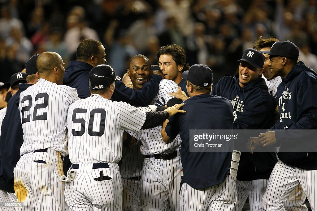 Marcus Thames #38 of the New York Yankees is congratulated by his teammates following his two-run walk off in the ninth inning to beat the Boston Red Sox on May 17, 2010 at Yankee Stadium in the Bronx borough of New York City.The Yankees defeated the Red Sox 11-9.