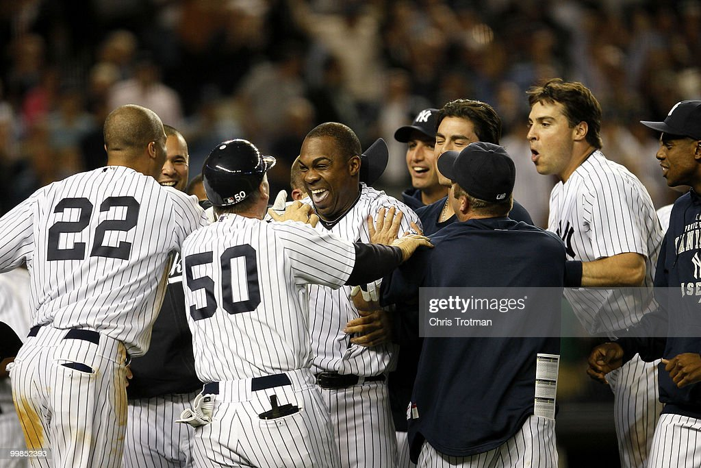 Marcus Thames #38 of the New York Yankees is congratulated by his teammates following his two-run walk off in the ninth inning to beat the Boston Red Sox on May 17, 2010 at Yankee Stadium in the Bronx borough of New York City. The Yankees defeated the Red Sox 11-9.