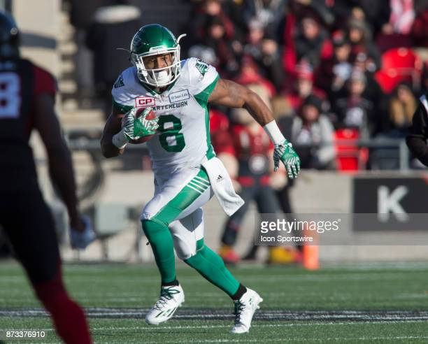 Marcus Thigpen of the Saskatchewan Roughriders runs the ball against the Ottawa Redblacks in Canadian Football League play during the CFL East...