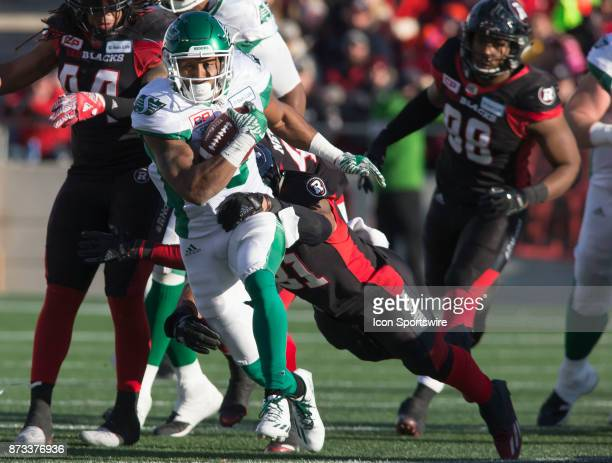 Marcus Thigpen of the Saskatchewan Roughriders tries to break an Ottawa Redblacks tackle in Canadian Football League play during the CFL East...