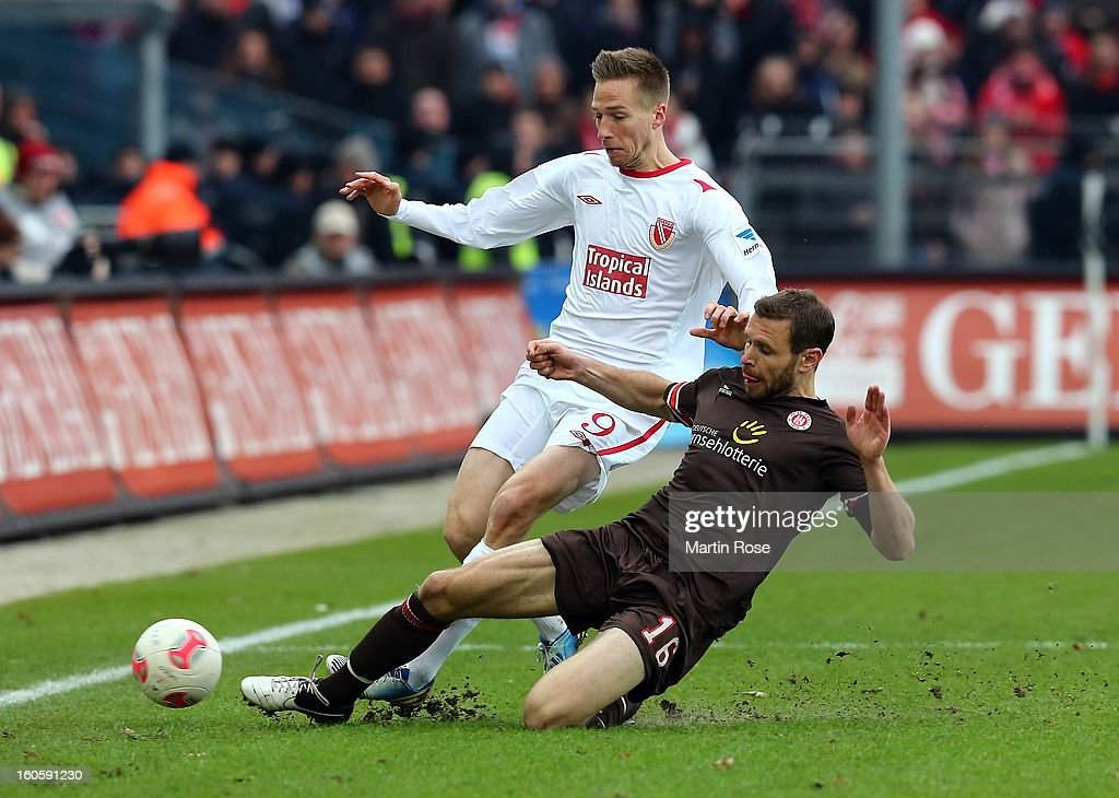 Marcus Thorandt (R) of St. Pauli and <a gi-track='captionPersonalityLinkClicked' href=/galleries/search?phrase=Marco+Stiepermann&family=editorial&specificpeople=3522227 ng-click='$event.stopPropagation()'>Marco Stiepermann</a> (L) of Cottbus battle for the ball during the second Bundesliga match between FC St. Pauli and Energie Cottbus at Millerntor Stadium at Millerntor Stadium on February 3, 2013 in Hamburg, Germany.