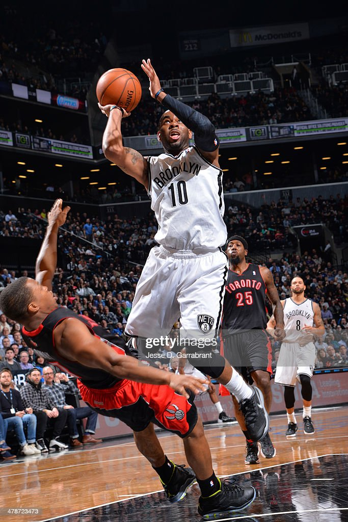 <a gi-track='captionPersonalityLinkClicked' href=/galleries/search?phrase=Marcus+Thornton+-+Basketball+Player+-+Born+1987&family=editorial&specificpeople=4679329 ng-click='$event.stopPropagation()'>Marcus Thornton</a> #10 of the Brooklyn Nets takes a shot against the Toronto Raptors on March 10, 2014 at the Barclays Center in Brooklyn, New York.