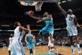 Marcus Thornton of the New Orleans Hornets shoots between Arron Afflalo and Melvin Ely of the Denver Nuggets on October 29 2010 at the New Orleans...