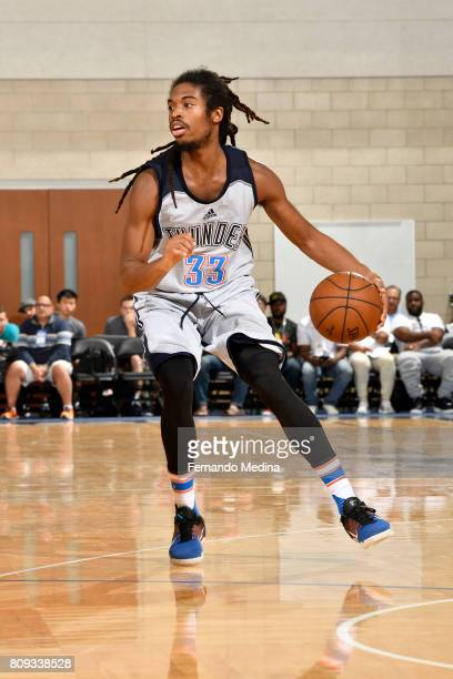 Marcus Thornton of the Oklahoma City Thunder dribbles the ball against the Dallas Mavericks during the Mountain Dew Orlando Pro Summer League on July...