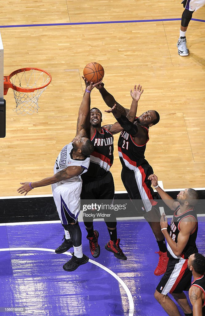 <a gi-track='captionPersonalityLinkClicked' href=/galleries/search?phrase=Marcus+Thornton+-+Basketball+Player+Born+1987&family=editorial&specificpeople=4679329 ng-click='$event.stopPropagation()'>Marcus Thornton</a> #23 of the Sacramento Kings challenges <a gi-track='captionPersonalityLinkClicked' href=/galleries/search?phrase=Wesley+Matthews+-+Basketball+Player&family=editorial&specificpeople=804816 ng-click='$event.stopPropagation()'>Wesley Matthews</a> #2 and <a gi-track='captionPersonalityLinkClicked' href=/galleries/search?phrase=J.J.+Hickson&family=editorial&specificpeople=4226173 ng-click='$event.stopPropagation()'>J.J. Hickson</a> #21 of the Portland Trail Blazers for the rebound on November 13, 2012 at Sleep Train Arena in Sacramento, California.