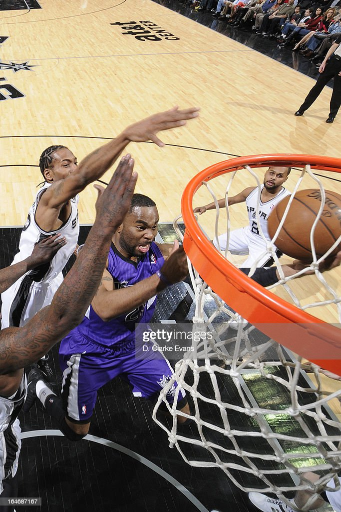 <a gi-track='captionPersonalityLinkClicked' href=/galleries/search?phrase=Marcus+Thornton+-+Basketball+Player+Born+1987&family=editorial&specificpeople=4679329 ng-click='$event.stopPropagation()'>Marcus Thornton</a> #23 of the Sacramento Kings drives to the basket against the San Antonio Spurs on March 1, 2013 at the AT&T Center in San Antonio, Texas.