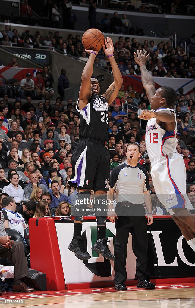 Marcus Thornton #23 of the Sacramento Kings goes for a jump shot against Eric Bledsoe #12 of the Los Angeles Clippers during the game between the Los Angeles Clippers and the Sacramento Kings at Staples Center on December 1, 2012 in Los Angeles, California.