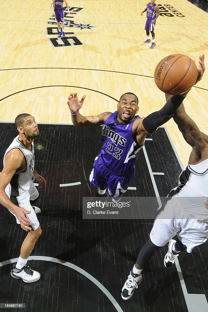 <a gi-track='captionPersonalityLinkClicked' href=/galleries/search?phrase=Marcus+Thornton+-+Basketball+Player+Born+1987&family=editorial&specificpeople=4679329 ng-click='$event.stopPropagation()'>Marcus Thornton</a> #23 of the Sacramento Kings goes up for a rebound against the San Antonio Spurs on March 1, 2013 at the AT&T Center in San Antonio, Texas.