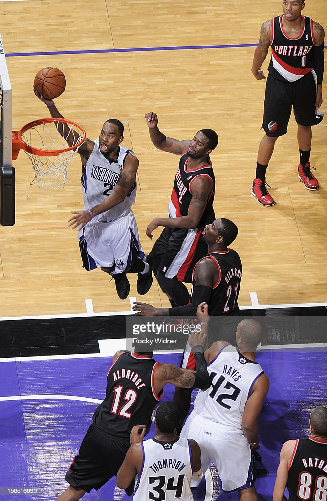 <a gi-track='captionPersonalityLinkClicked' href=/galleries/search?phrase=Marcus+Thornton+-+Basketball+Player+Born+1987&family=editorial&specificpeople=4679329 ng-click='$event.stopPropagation()'>Marcus Thornton</a> #23 of the Sacramento Kings goes up for a shot against <a gi-track='captionPersonalityLinkClicked' href=/galleries/search?phrase=Wesley+Matthews+-+Basketball+Player&family=editorial&specificpeople=804816 ng-click='$event.stopPropagation()'>Wesley Matthews</a> #2 of the Portland Trail Blazers on November 13, 2012 at Sleep Train Arena in Sacramento, California.