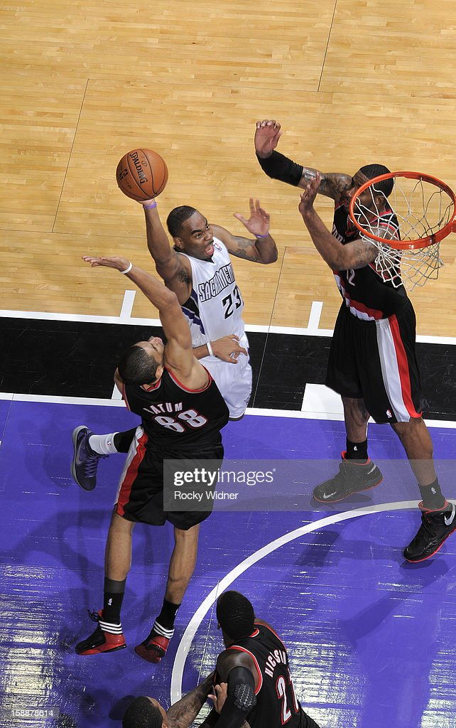 <a gi-track='captionPersonalityLinkClicked' href=/galleries/search?phrase=Marcus+Thornton+-+Basketball+Player+Born+1987&family=editorial&specificpeople=4679329 ng-click='$event.stopPropagation()'>Marcus Thornton</a> #23 of the Sacramento Kings goes up for the shot against the Portland Trail Blazers on December 23, 2012 at Sleep Train Arena in Sacramento, California.