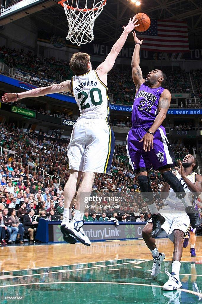 Marcus Thornton #23 of the Sacramento Kings is blocked by Gordon Hayward #20 of the Utah Jazz at Energy Solutions Arena on November 23, 2012 in Salt Lake City, Utah.