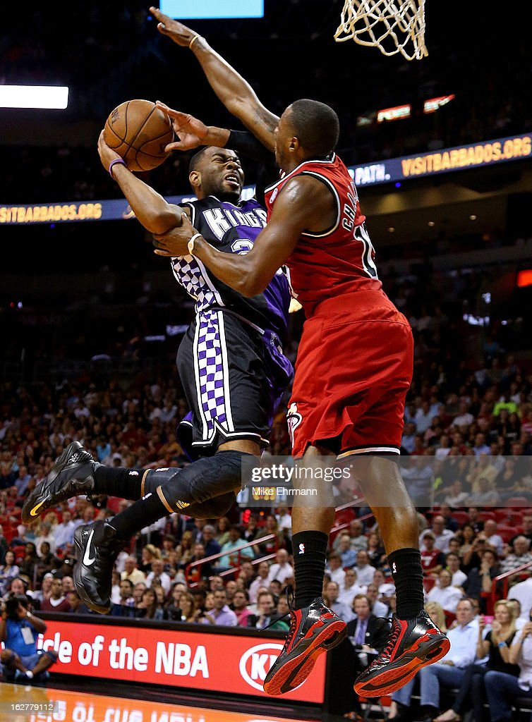 Marcus Thornton #23 of the Sacramento Kings is challenged by Mario Chalmers #15 of the Miami Heat during a game at American Airlines Arena on February 26, 2013 in Miami, Florida.