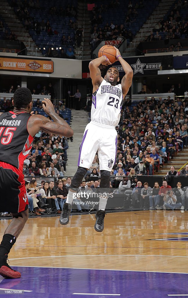 <a gi-track='captionPersonalityLinkClicked' href=/galleries/search?phrase=Marcus+Thornton+-+Basketball+Player+Born+1987&family=editorial&specificpeople=4679329 ng-click='$event.stopPropagation()'>Marcus Thornton</a> #23 of the Sacramento Kings shoots over <a gi-track='captionPersonalityLinkClicked' href=/galleries/search?phrase=Amir+Johnson&family=editorial&specificpeople=556786 ng-click='$event.stopPropagation()'>Amir Johnson</a> #15 of the Toronto Raptors on December 5, 2012 at Sleep Train Arena in Sacramento, California.