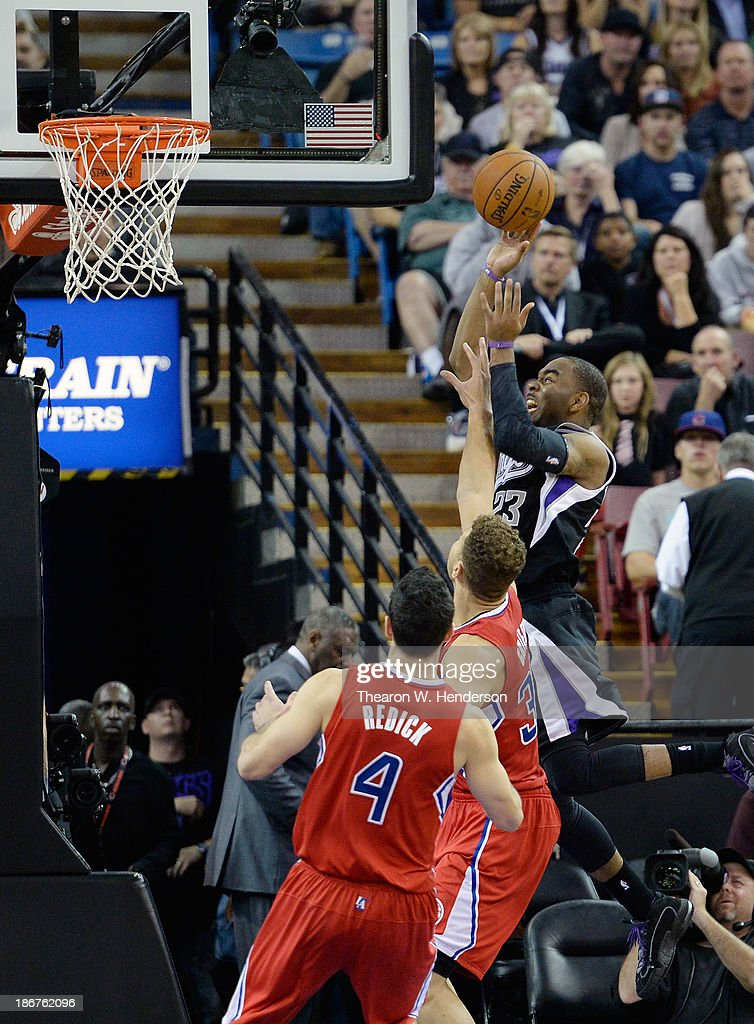 Marcus Thornton #23 of the Sacramento Kings shoots over Blake Griffin #32 of the Los Angeles Clippers at Sleep Train Arena on November 1, 2013 in Sacramento, California.