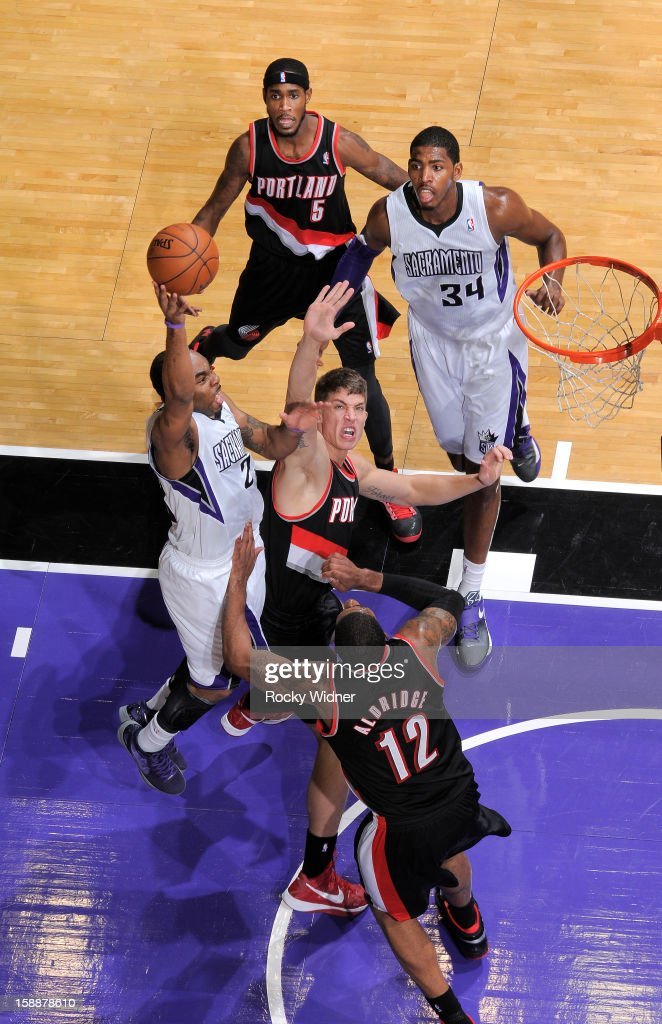 <a gi-track='captionPersonalityLinkClicked' href=/galleries/search?phrase=Marcus+Thornton+-+Basketball+Player+Born+1987&family=editorial&specificpeople=4679329 ng-click='$event.stopPropagation()'>Marcus Thornton</a> #23 of the Sacramento Kings shoots over <a gi-track='captionPersonalityLinkClicked' href=/galleries/search?phrase=Meyers+Leonard&family=editorial&specificpeople=6893999 ng-click='$event.stopPropagation()'>Meyers Leonard</a> #11 and <a gi-track='captionPersonalityLinkClicked' href=/galleries/search?phrase=LaMarcus+Aldridge&family=editorial&specificpeople=453277 ng-click='$event.stopPropagation()'>LaMarcus Aldridge</a> #12 of the Portland Trail Blazers on December 23, 2012 at Sleep Train Arena in Sacramento, California.