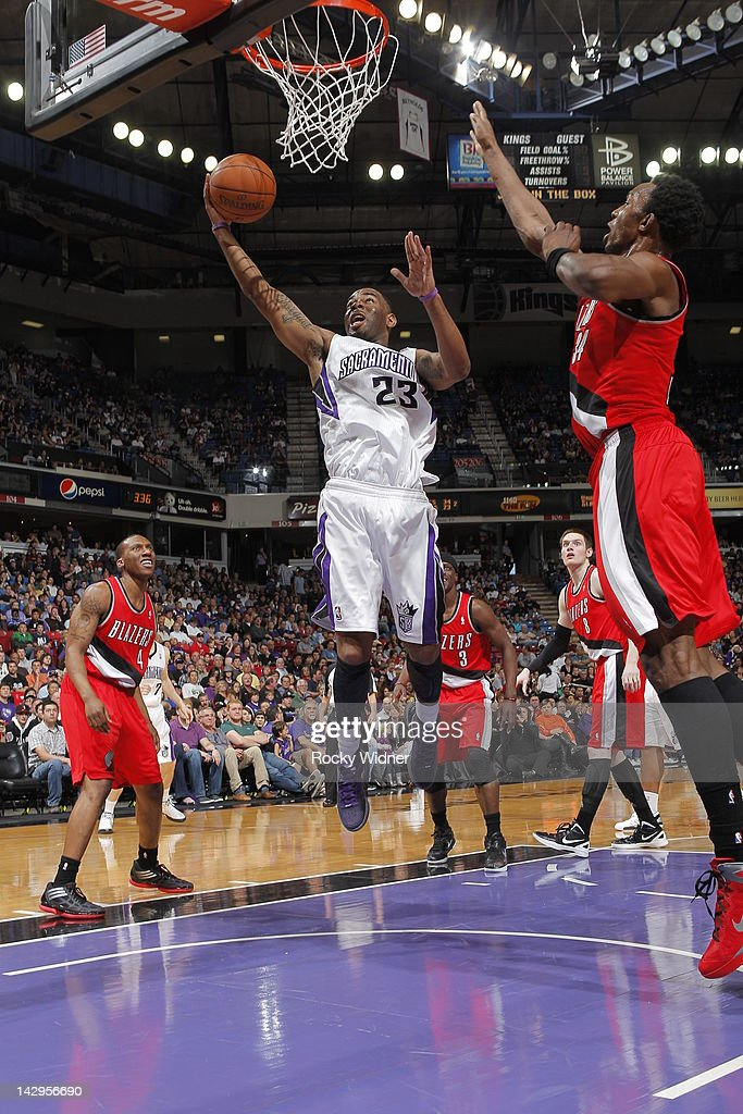 <a gi-track='captionPersonalityLinkClicked' href=/galleries/search?phrase=Marcus+Thornton+-+Basketball+Player+Born+1987&family=editorial&specificpeople=4679329 ng-click='$event.stopPropagation()'>Marcus Thornton</a> #23 of the Sacramento Kings shoots the ball against <a gi-track='captionPersonalityLinkClicked' href=/galleries/search?phrase=Hasheem+Thabeet&family=editorial&specificpeople=4003778 ng-click='$event.stopPropagation()'>Hasheem Thabeet</a> #34 of the Portland Trail Blazers on April 15, 2012 at Power Balance Pavilion in Sacramento, California.