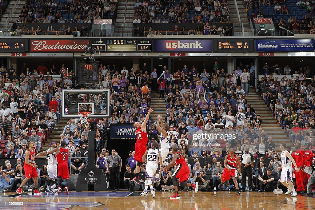 <a gi-track='captionPersonalityLinkClicked' href=/galleries/search?phrase=Marcus+Thornton+-+Basketball+Player+Born+1987&family=editorial&specificpeople=4679329 ng-click='$event.stopPropagation()'>Marcus Thornton</a> #23 of the Sacramento Kings shoots the game winner against the Portland Trail Blazers on April 15, 2012 at Power Balance Pavilion in Sacramento, California.