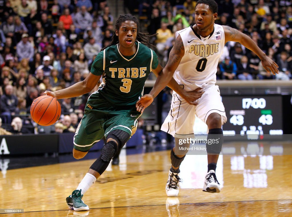 Marcus Thornton #3 of the William & Mary Tribe dribbles the ball to the basket past Terone Johnson #0 of the Purdue Boilermakers at Mackey Arena on December 29, 2012 in West Lafayette, Indiana. Purdue defeated William & Mary 73-66.