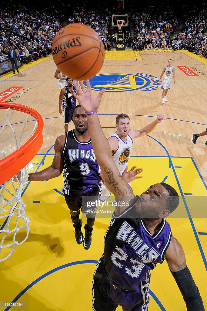 Marcus Thorton #23 of the Sacramento Kings reaches for a rebound against the Golden State Warriors on March 6, 2013 at Oracle Arena in Oakland, California.