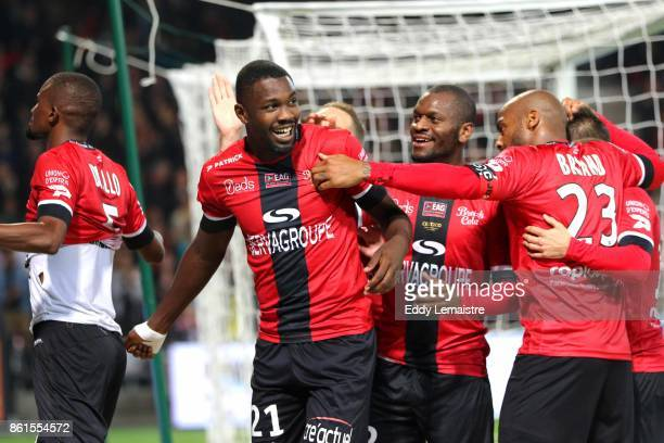 Marcus Thuram of Guingamp celebrates with Jimmy Briand of Guingamp during the Ligue 1 match between EA Guingamp and Stade Rennais at Stade du...
