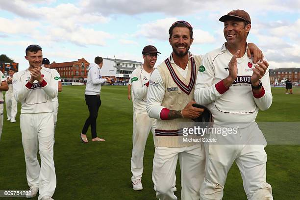 Marcus Trescothick and Peter Trego during a lap of honour concluding their sides 325 run victory during day three of the Specsavers County...